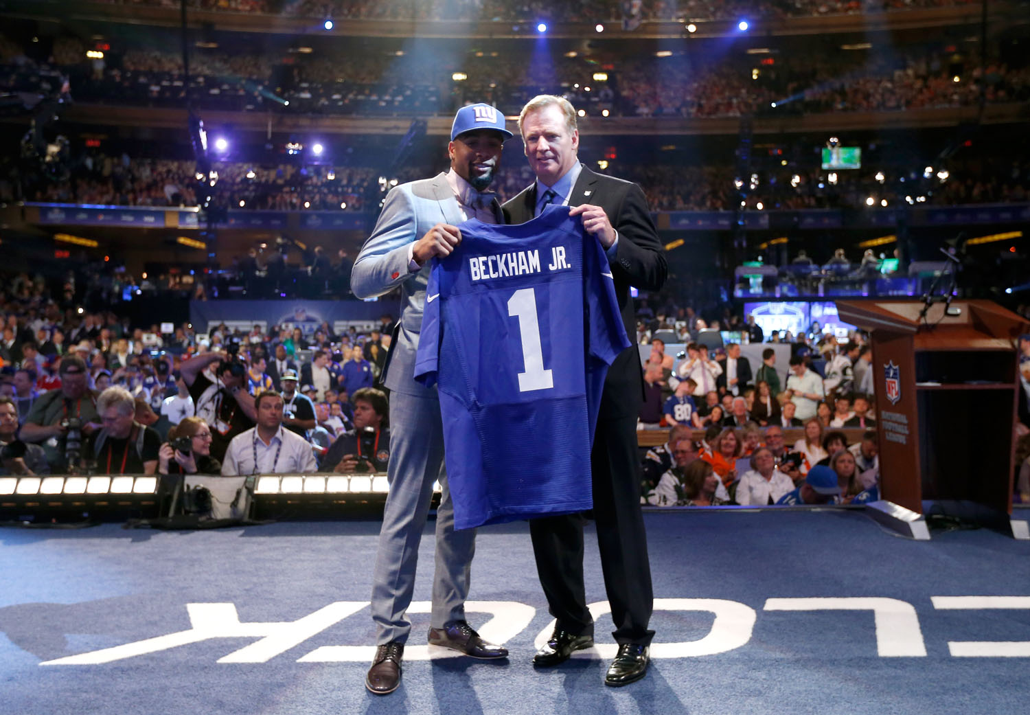 Odell Beckham Jr. Poses With NFL Commissioner Roger Goodell After Being  Selected By The New York Giants With The 12th Overall Pick Of The 2014 NFL  Draft.